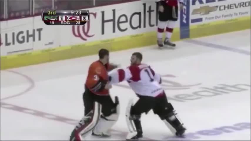 Adam Vay knocks opposing goalie to the ground