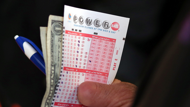 Holding Powerball ticket with cash_22582172_ver1.0_640_360_1503346196364.jpg