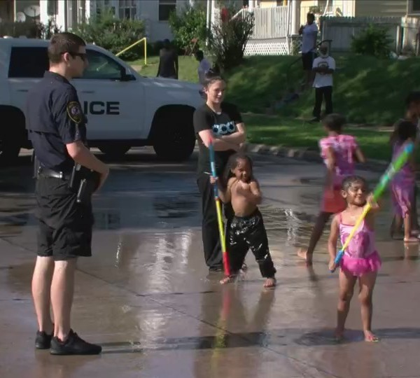Police make street water park for hot kids to cool off