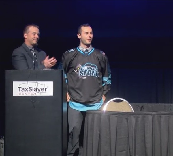 QC Storm coach on his new team.