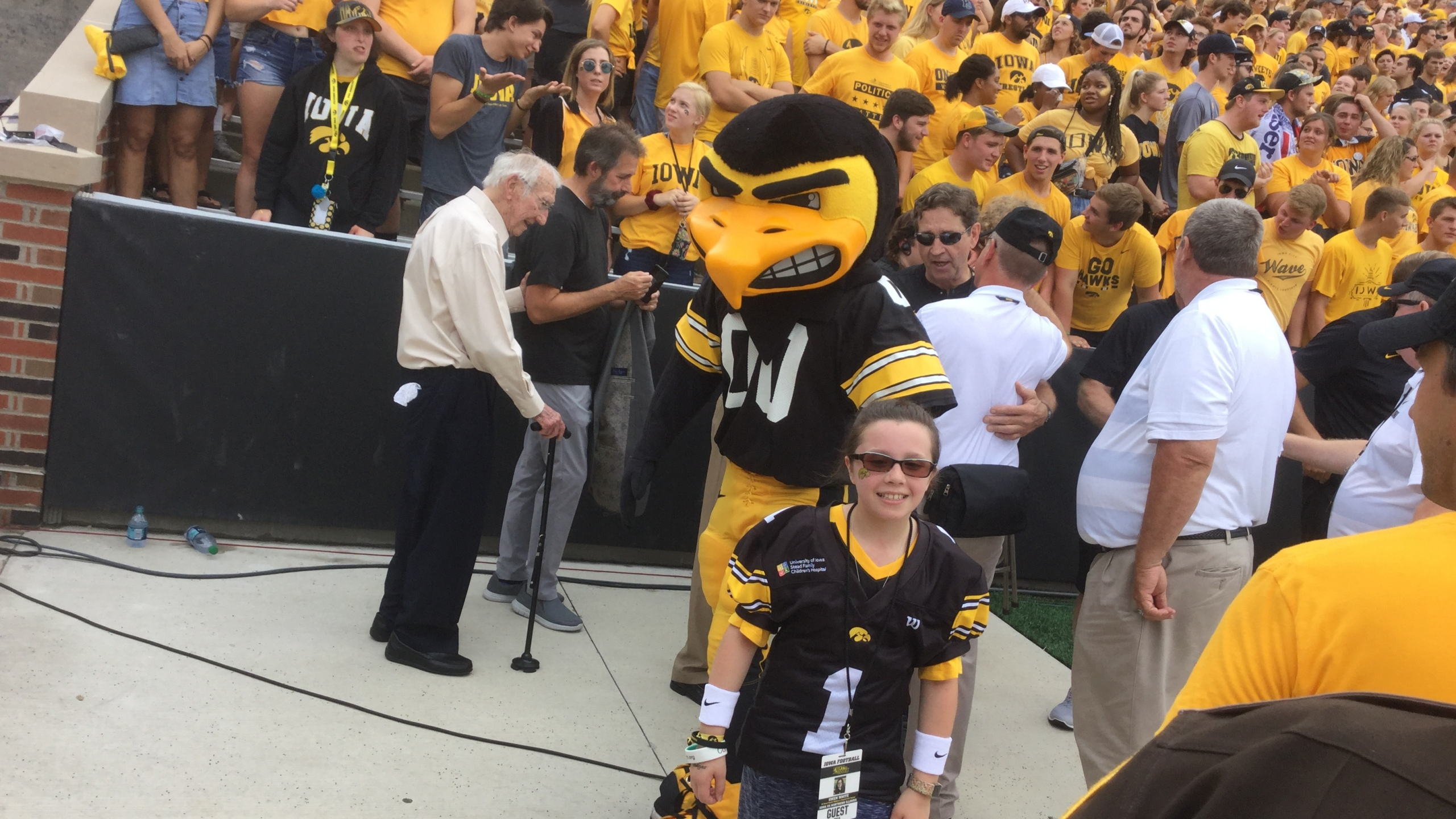 Herky with Kid Captain Gwen White