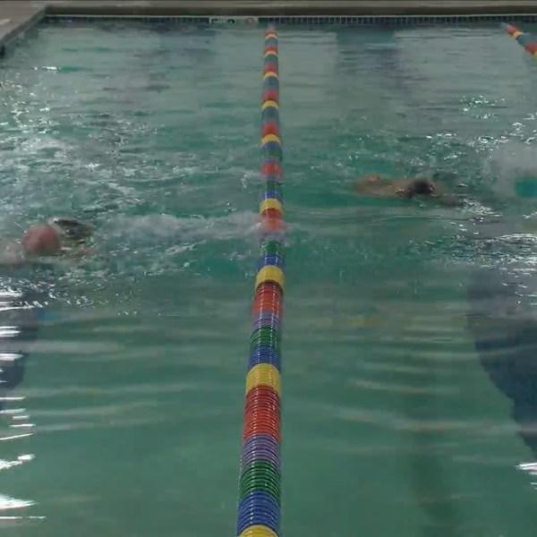 Go 4 It: Mickey swim race.