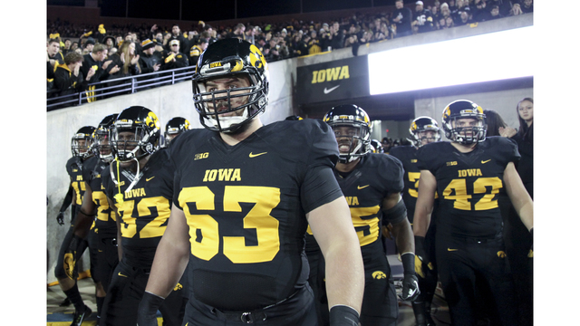 release date: 5fc8b ccee6 Hawkeyes unveil first gold uniform with throwback 'wings ...