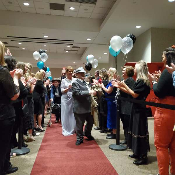 Volunteers greet guests on the red carpet at the 'Night to Shine.'