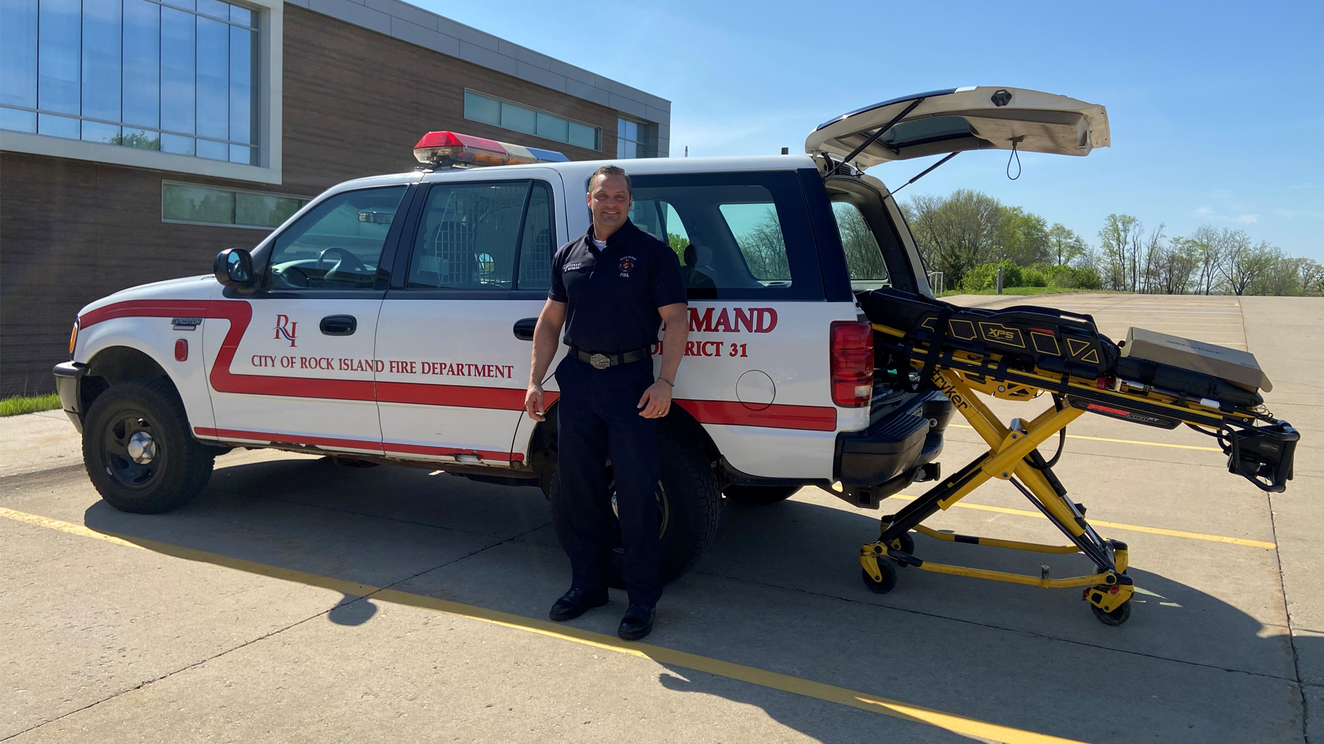 Chris Rogers of the Rock Island Fire Department poses with the Stryker power cot that was recently donated to the Black Hawk College EMS program.