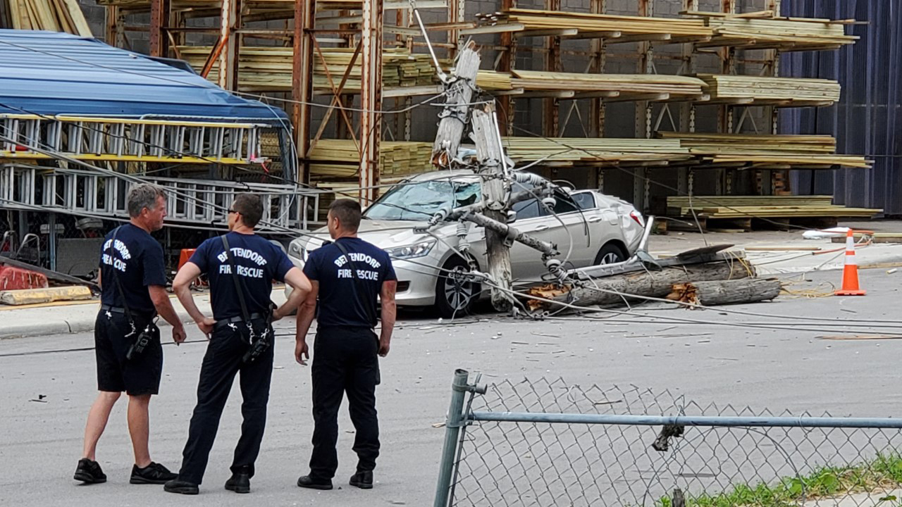 An accident caused a utility pole to fall on a car at 19th and Grant Street in Bettendorf on June 10, 2020 around 2pm (photo: Ryan Risky, OurQuadCities.com).