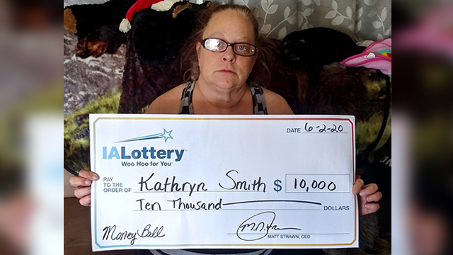 "Kathryn Smith, 52, of Davenport, won $10,000 in the Iowa Lottery's ""Money Ball"" scratch game."