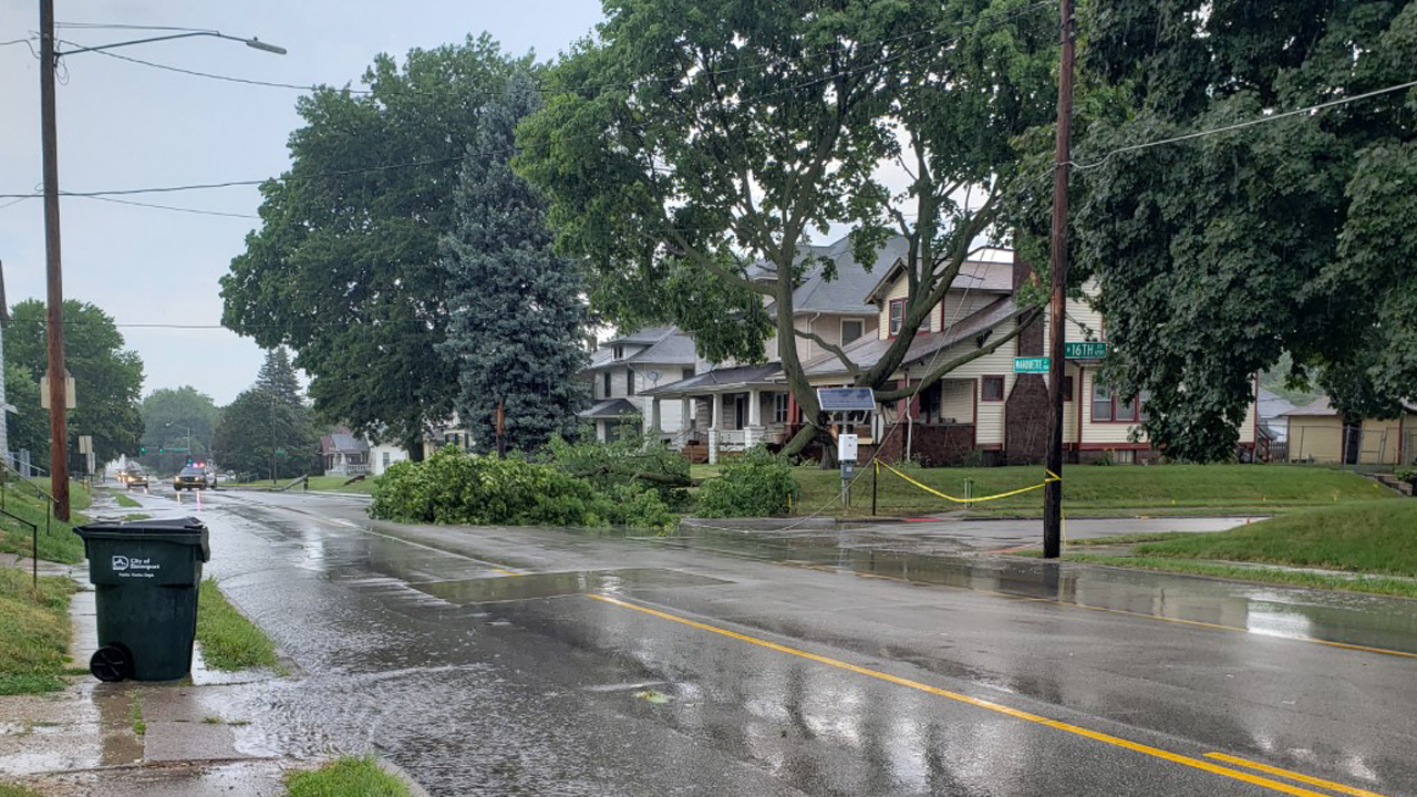 A tree fell on power lines on Marquette Street in Davenport on July 8, 2020 (photo: Bryan Bobb, OurQuadCities.com).