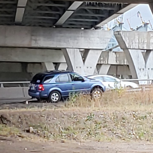 A car got stuck on an I-74 on ramp retaining wall in Moline on October 21, 2020 (photo: Bryan Bobb, OurQuadCities.com).