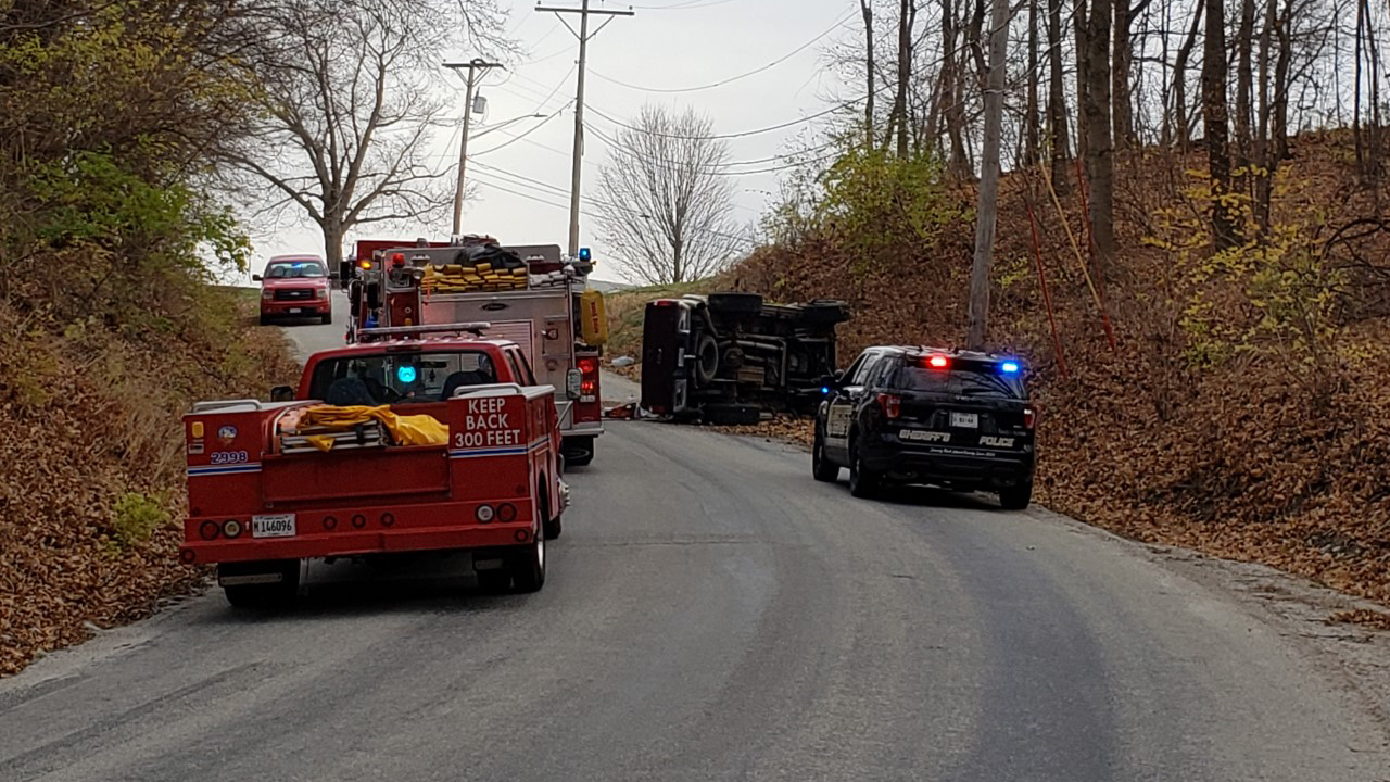 A pick-up truck ended up on its side due to an accident in which a woman had to be rescued in the 5100 block of 18th Street North in East Moline, Illinois on November 23, 2020 (photo: Bryan Bobb, OurQuadCities.com).