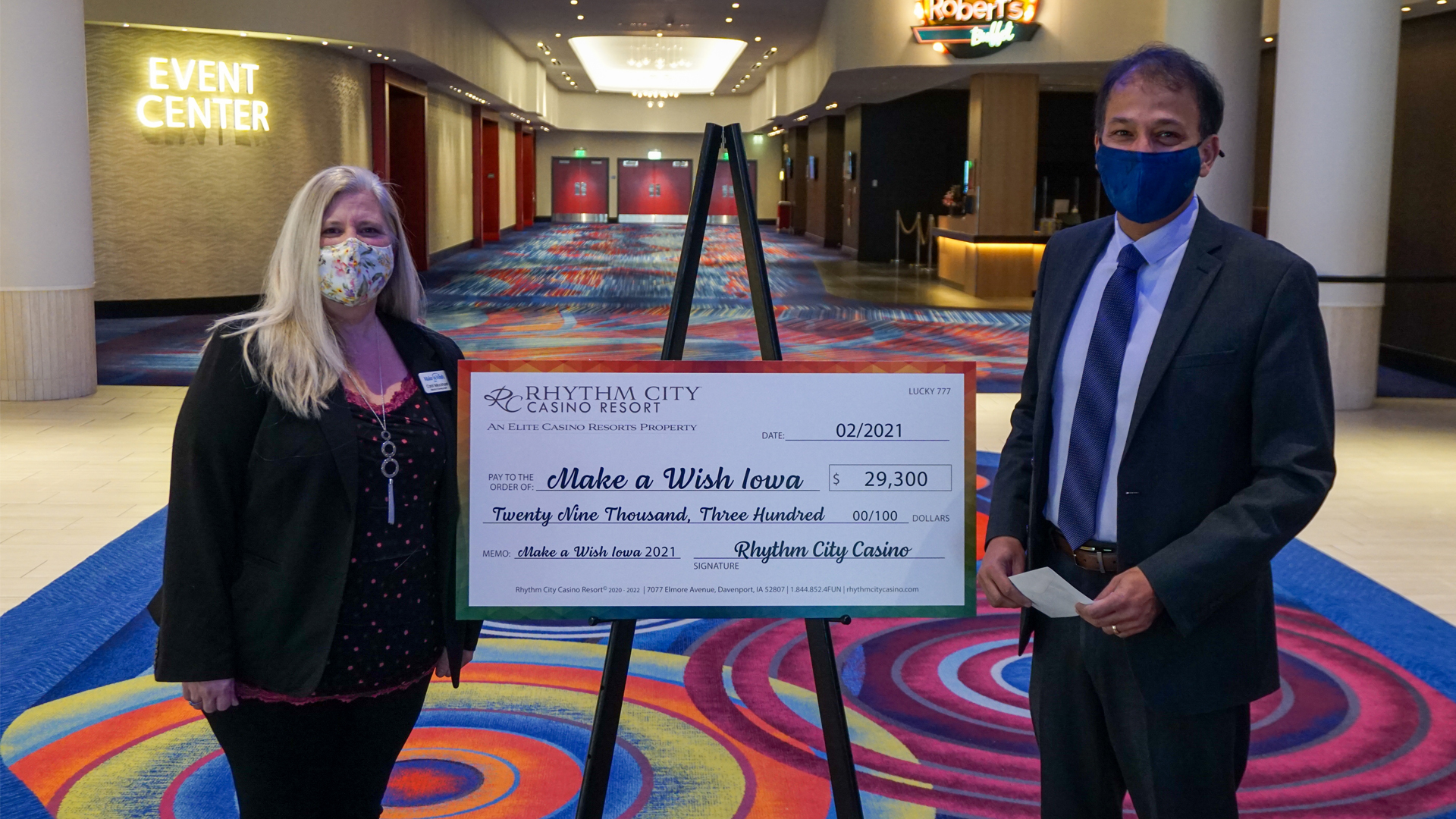 Rhythm City Casino Resort General Manager Mo Hyder presents a check to Carol TeBockhorst with Make-A-Wish Iowa Chapter on February 18, 2021.