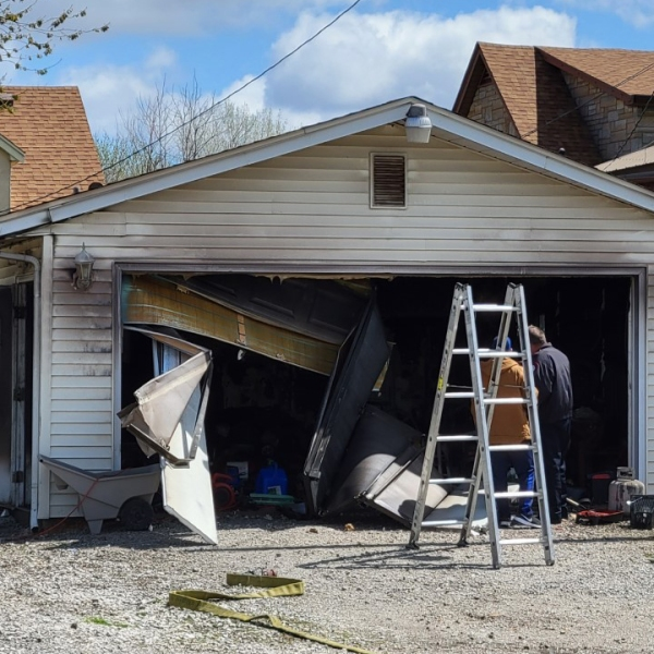 A garage in the 300 block of 21st Street in East Moline is damaged by fire on April 12, 2021 (photo: Bryan Bobb, OurQuadCities.com).